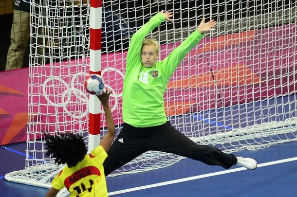 Russia's goalkeeper Maria Sidorova tries
